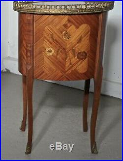 A Pair of French Oval Inlaid Bedside Drawer Tables
