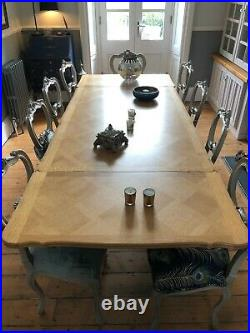 Antique French Oak Expanding Dining table with 8 Reproduction chairs