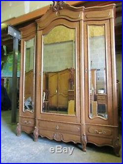 Antique French carved oak 3 door mirrored armoire w drawers, wardrobe, flat pack