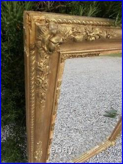 Antique mirror, large French gilt overmantel, slightly foxed, wood/gesso frame
