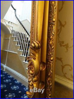 Fabulous Extra Tall gold gilt French Wall hall leaner mirror. Ornate & Opulent
