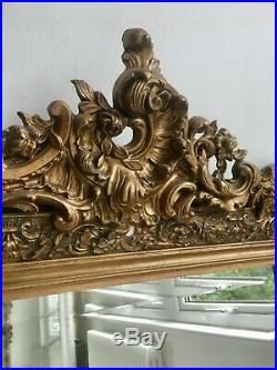 French antique gilt crested mirror