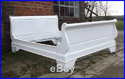 Good large king size white French sleigh bed sumptuous curves