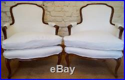 Pair of Vintage French Louis XV Bergere Armchairs in a White Linen Fabric