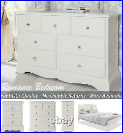 Romance French style bedroom furniture. Antique white chest, wardrobe, bedside